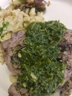 Rolled flanks steak topped with chimichurri
