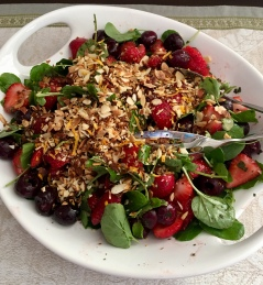 Salad with watercress, strawberries, cherries