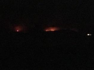 Nighttime view from Redondo Beach of Malibu fires across the Santa Monica Bay.
